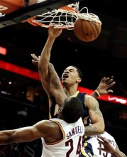 Pacers' Gerald Green dunks over Samardo Samuels. (Associated Press/Tony Dejak)