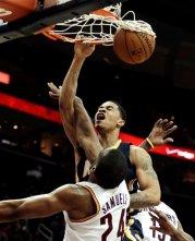 Pacers' Gerald Green dunks over Samardo Samuels. (Associated Press/Tony Dejak)