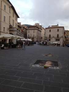 Street art in Assisi's main piazza