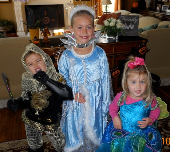 My three girls! We try to make costumes and visiting neighbors the highlight of Halloween.