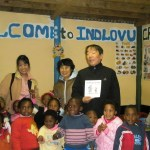 Late Masaru Emoto in Cape Tow with kids from the Indlovu creche