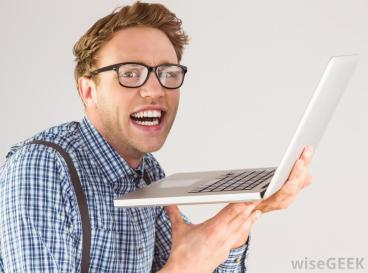 nerdy-man-in-checkered-shirt-with-computer