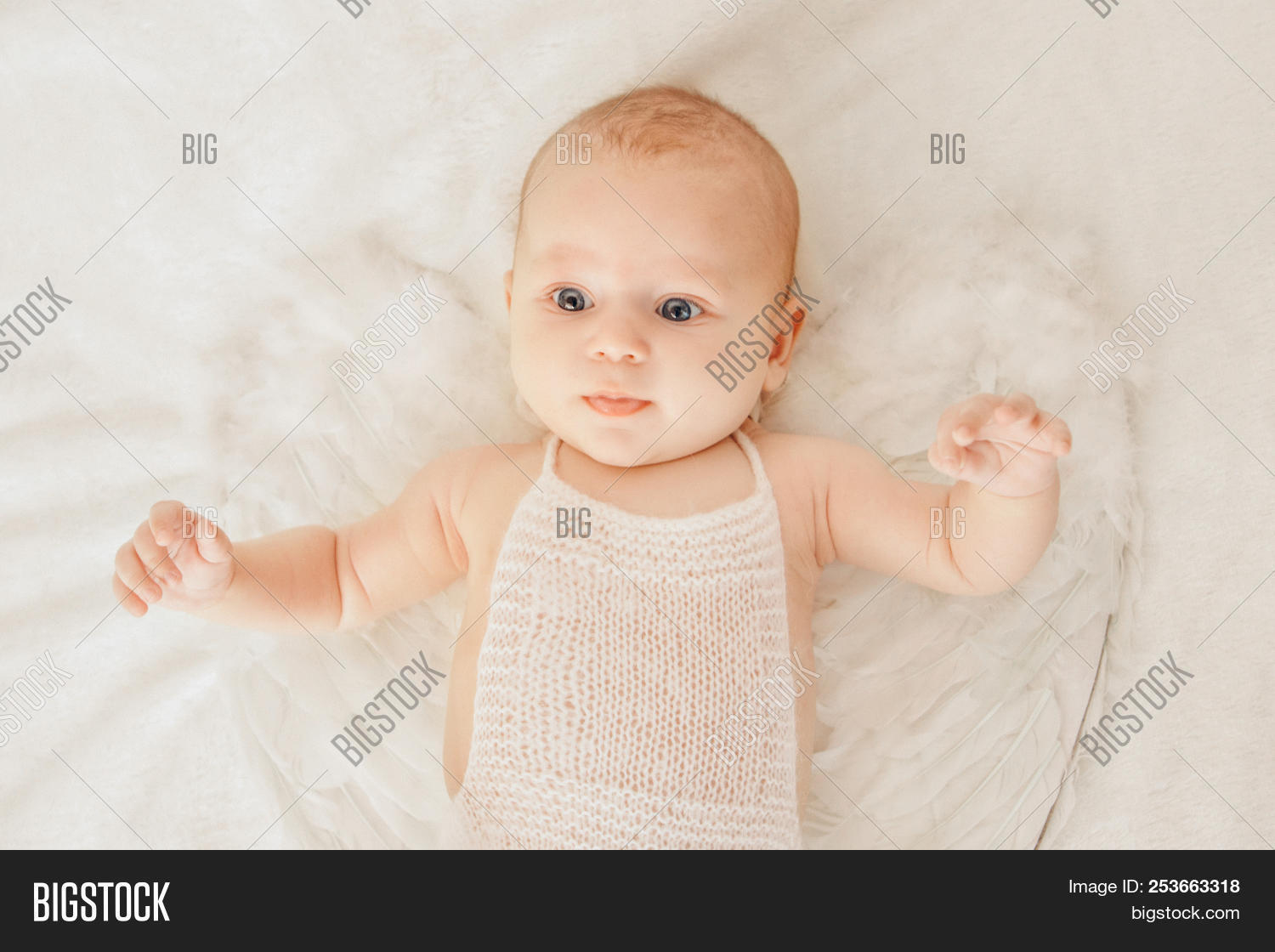 Newborn Babies With Blue Eyes Blue Eyed Baby With Angel Wings Behind Him Lying On His