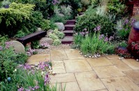 Spring patio garden with bench | Plant & Flower Stock ...