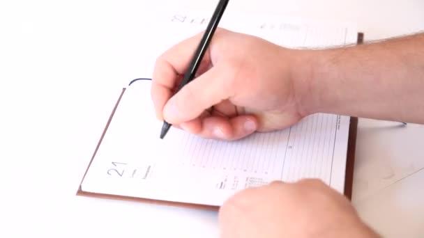 Man writing information in business agenda book \u2014 Stock Video
