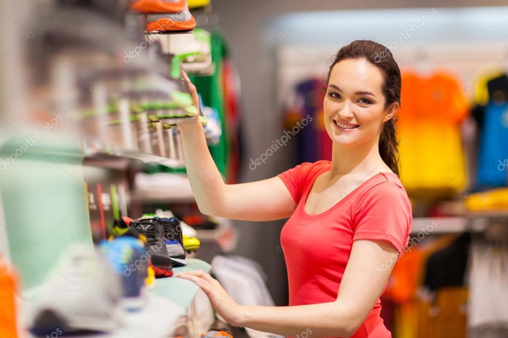 Sportswear shop assistant portrait inside store \u2014 Stock Photo