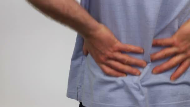 Massaging the Back Pain Away \u2014 Stock Video © serenethos #13636616
