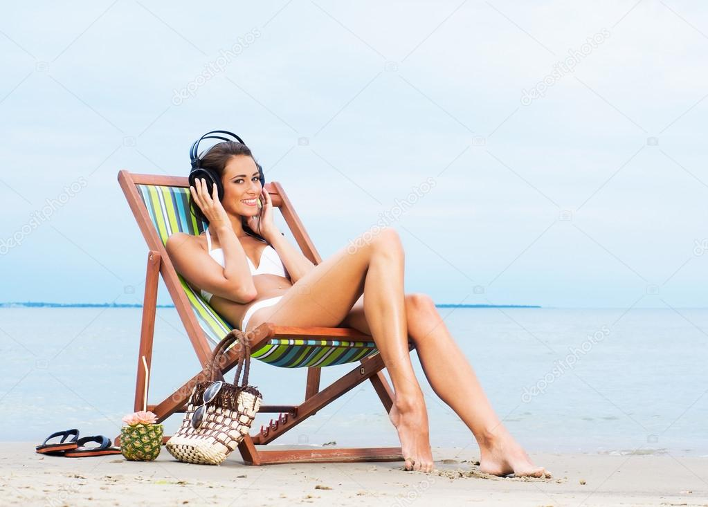 Sporty Girl Wallpaper Sexy Woman Listening To The Music On The Beach Stock