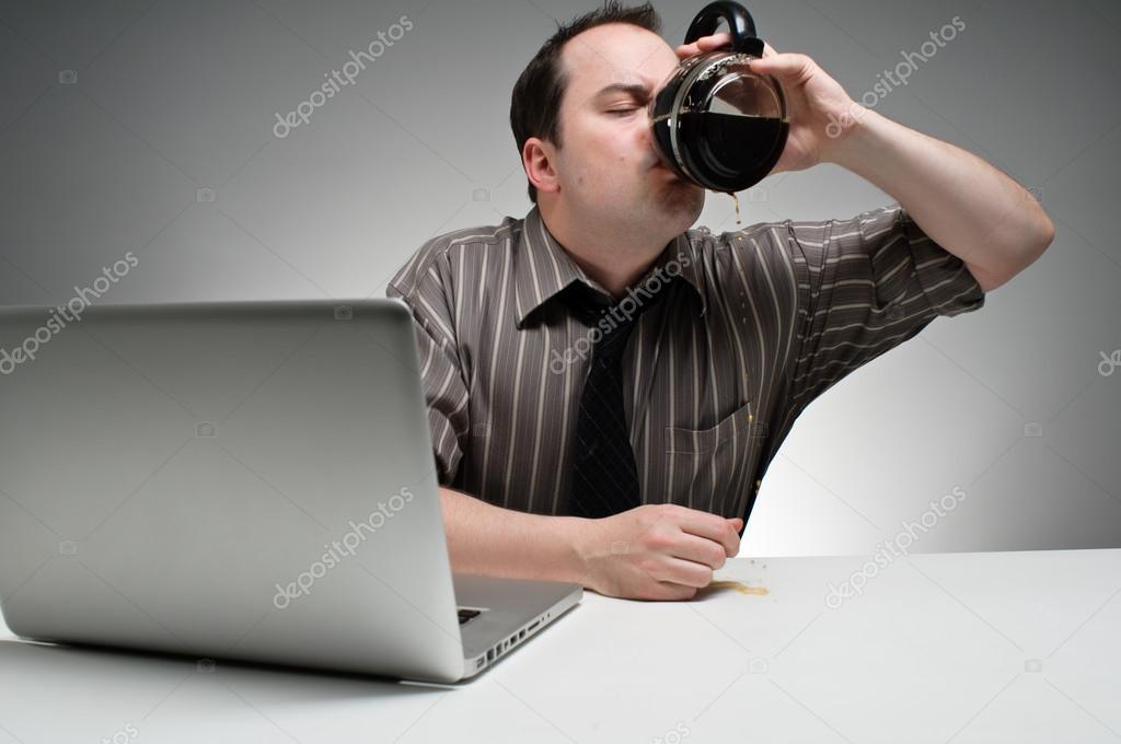 Man Drinking Coffee To Stay Awake At Work \u2014 Stock Photo © Camrocker