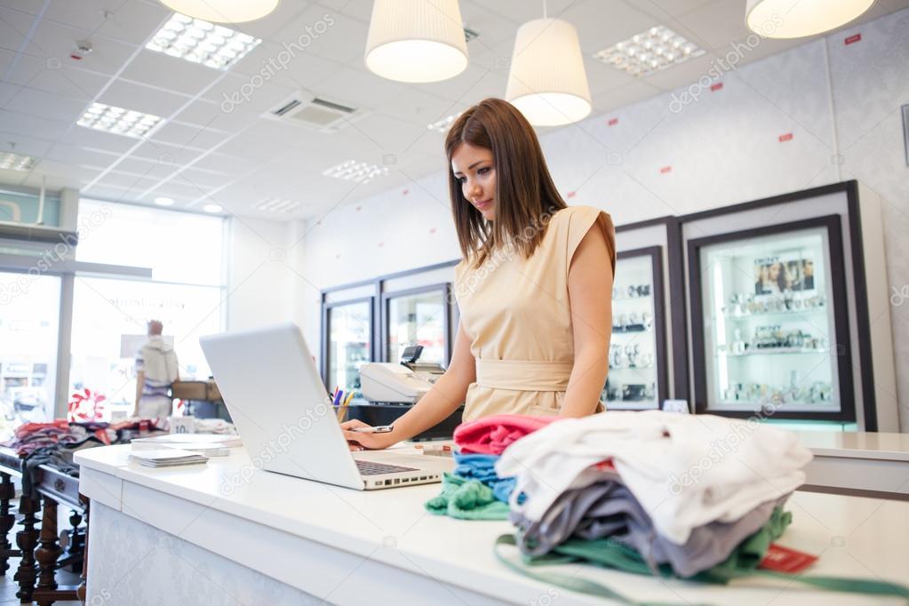 Shop Assistant at a Clothes Store \u2014 Stock Photo © luminastock #34734907 - shop assistan