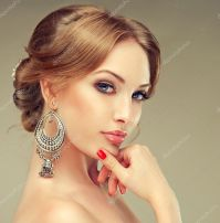 Beautiful woman with earrings  Stock Photo  EdwardDerule