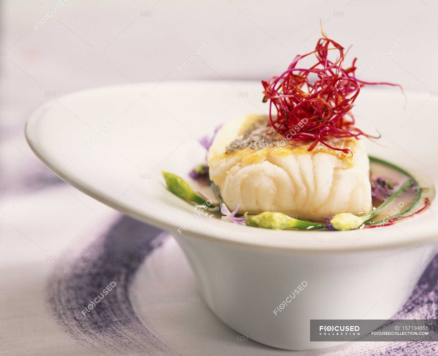 Cuisine Mauve Cod With Mauve Soup And Chinese Garlic In White Bowl Color