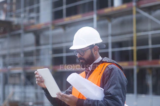 Side view of civil engineer working with digital tablet \u2014 Stock