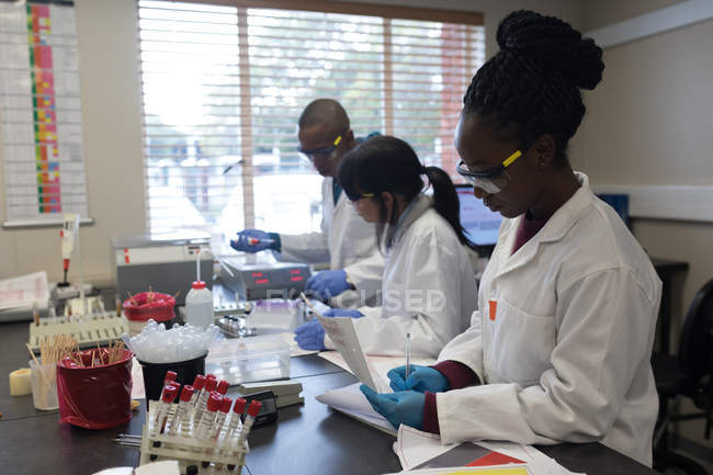 Laboratory technicians working together in blood bank \u2014 medical