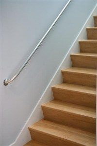 Angled riser maple stairs.