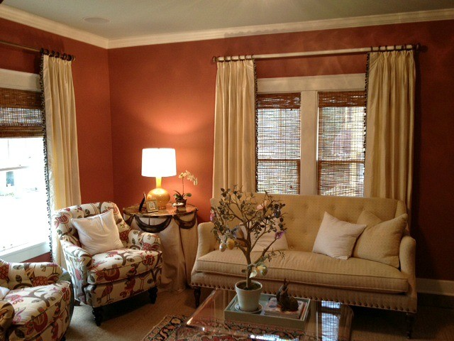 Cream silk curtain panels with trim down leading edge traditional