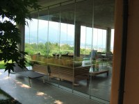 Patio closed off with folding glass doors, water and