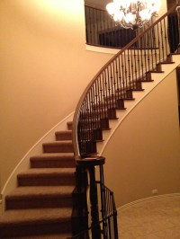 Elegant staircase and foyer, but curve of the wall(s) make ...