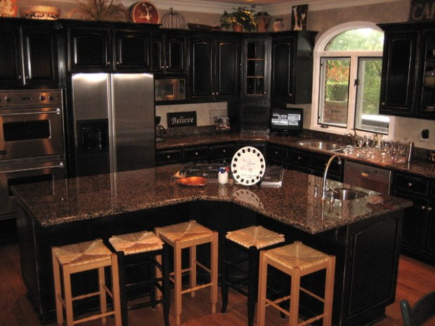 handpained and distressed black kitchen cabinets