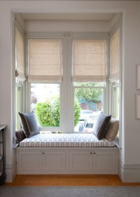 Motorized Roman Shades in a bay window and built in window ...