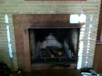 tile over brick fireplace