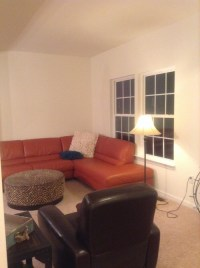 What wall paint color to go with orange sofa?