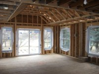 Framing stage view of living room with cathedral ceiling ...