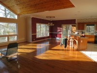 Color scheme for a sun drenched room with open floor plan