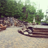 waterfall natural fieldstone walls with two tiered paver ...