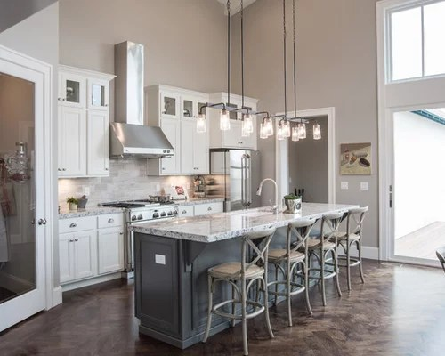 Kitchen With White Cabinets And Quartz Counter Tops Sherwin Williams Collonade Gray Home Design Ideas