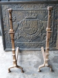 - Antique andirons by Charles Nijman