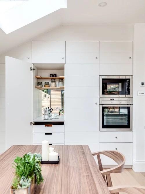area hidden door home design ideas pictures remodel decor scandinavian kitchen design ideas remodel pictures houzz