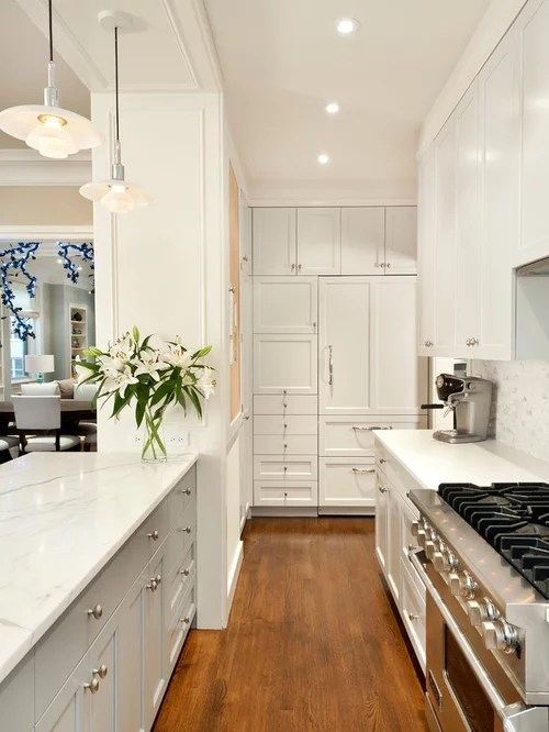 Small U Shaped Kitchen With Island White Corian Countertop | Houzz