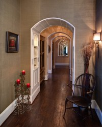Traditional (with a twist) Arched Hallway to Private Rooms ...