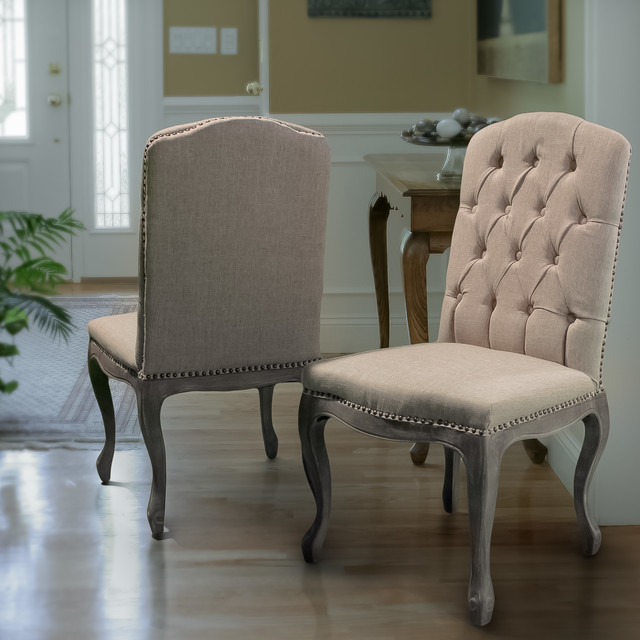 Contemporary Living Space Featuring Beige Fabric Dining Chairs - living spaces dining room sets