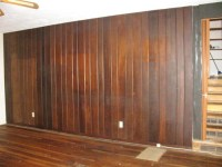 I need ideas for a dark wood paneled wall in living room.