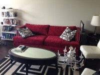 Decorating around red sofa in modern apartment.