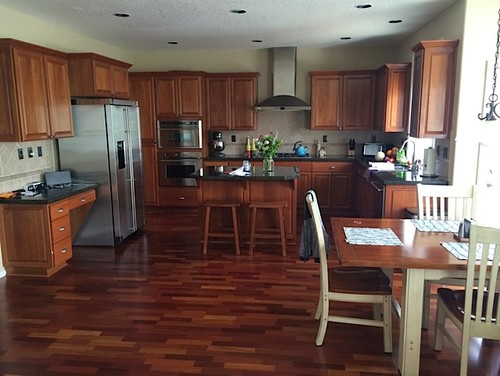 Paint Color For open kitchen\/living room with lots of Cherrywood - mindful gray living room