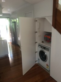 Laundry moved to utilise space under stairs