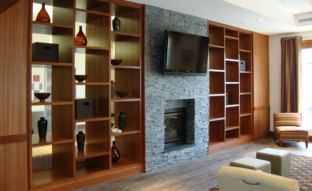 Dark Stacked Stone Fireplace with Built Ins - Contemporary - Living