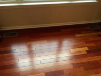 Multicolored wood floors, light gray walls?