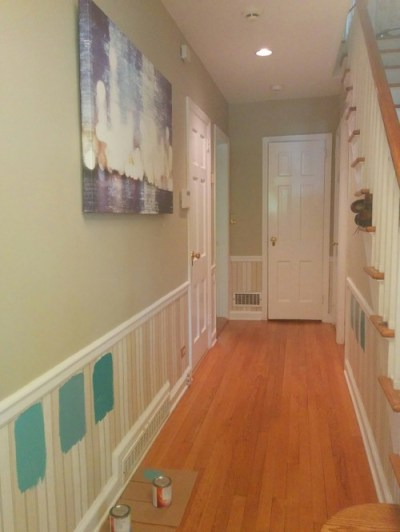 Different paint shade below chair rail in foyer.