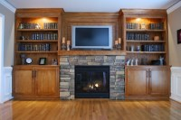 Custom built-in cabinets and stone surround fireplace ...
