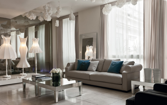 Beautiful beige living room with grey sofa and mirrored tables - grey and beige living room