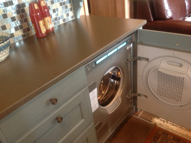 Hutch Hiding Asko Washer And Dryer - Traditional - Laundry Room