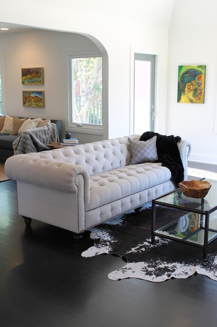 Houzz Rug Sale Cowhide Rug And Linen Chesterfield Sofa - Eclectic