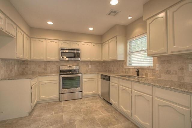 granite counter top ceramic tile floor broken joint pattern stone kitchen backsplash traditional kitchen