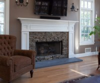 Fireplace mantle in white with stacked stone surround set