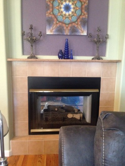 Paintable wallpaper on tile fireplace surround?