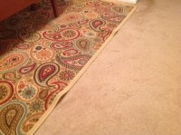 How to keep area rug on carpet flat?